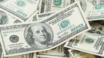 El dólar cerró casi estable a $63,09